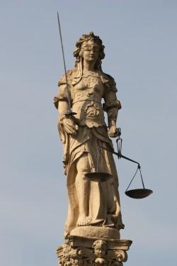 Lady Justice, atop the Fontaine de la Justice in Cudrefin, Switzerland. Source: Wikimedia