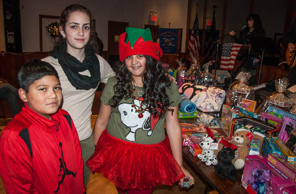 Students from St. Mark School served as Santa's little helpers at the event, piling the donated toys and greeting guests.
