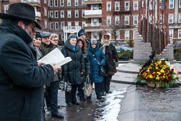 Rabbi Menahem Zarkh leads the memorial service in prayer.