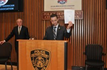 RAOA President Belogorodsky holds up NYPD Commissioner Bill Bratton's official stamp of approval. (Source: RAOA)